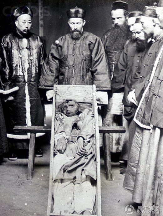 ca. 1840-1930, Tibet? --- The corpse of a murdered missionary lies in a coffin. --- Image by ©Sean Sexton Collection/CORBIS