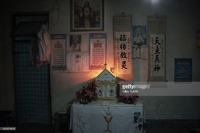 "YUTONG, HENAN, CHINA - 2014/08/05: The prayer room at the home of Father Dong, an ""underground"" catholic priest. Millions of Catholics in China outside the patronage of the government controlled Chinese Patriotic Catholic Association. These ""underground"" catholic who recognized the Vatican as the only religious authority when it comes to their faith, are under the threat of harassment and imprisonment by the Chinese. authorities. (Photo by Gilles Sabrie/LightRocket via Getty Images)"