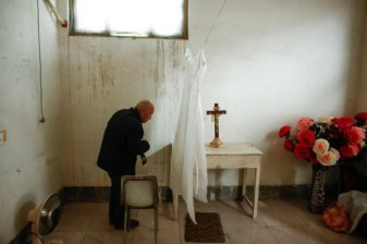 Pei Ronggui, an 81-year-old retired bishop waits to take confession from members of the congregation before Sunday service at an unofficial catholic church in Youtong village, Hebei Province, China, December 11, 2016. Picture taken December 11, 2016. REUTERS/Thomas Peter